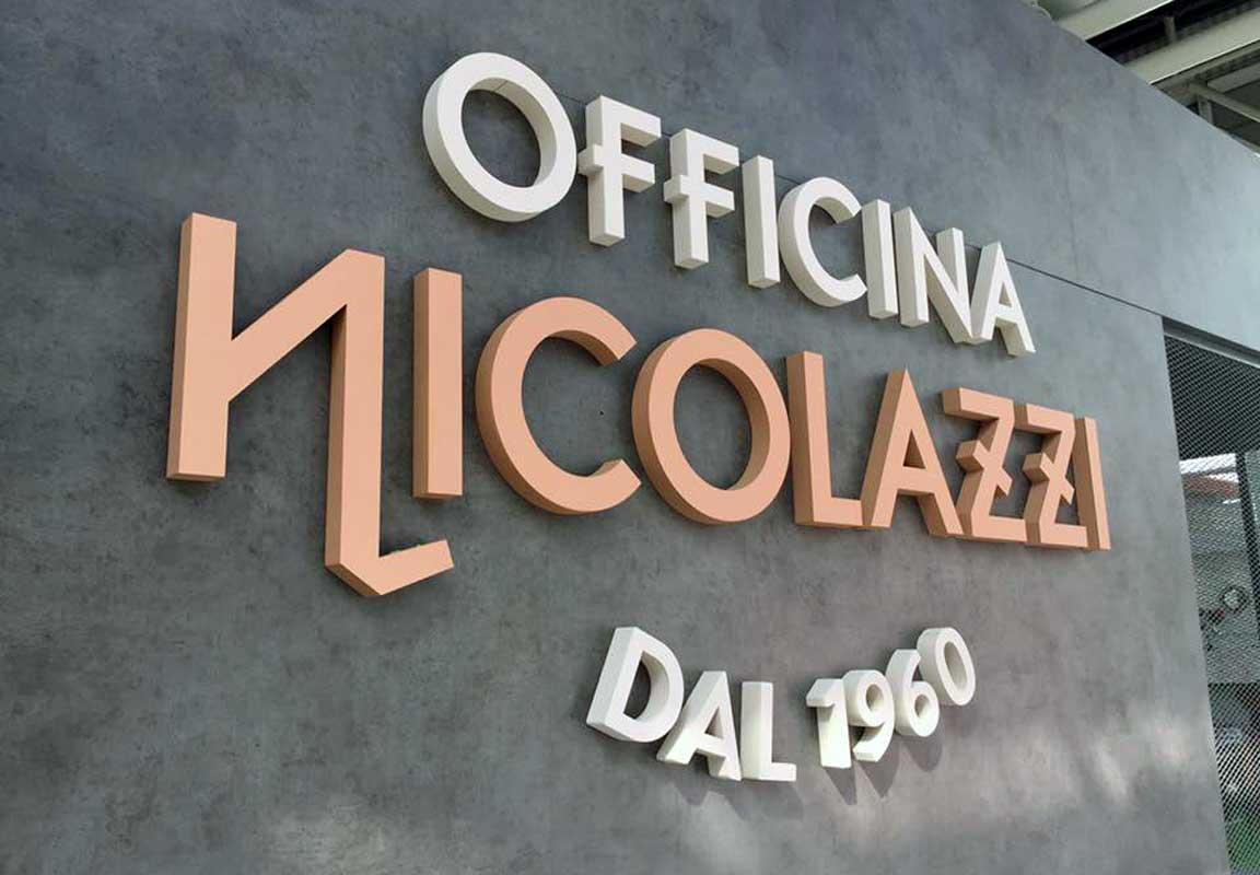 scritta in polistirolo per stand Officina Nicolazzi